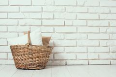 Wicker basket with a pillow Royalty Free Stock Image