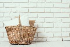 Wicker basket with a pillow Stock Photos