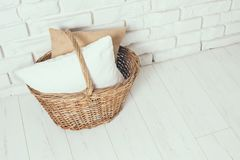 Wicker basket with a pillow stock photography