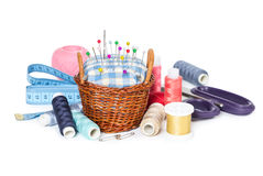 Wicker basket with pincushion and accessories Stock Photography