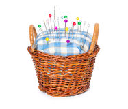 Wicker basket with pincushion Royalty Free Stock Images