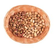Wicker basket with pistachios. Royalty Free Stock Photos