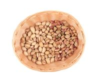 Wicker basket with pistachios. Stock Images