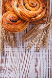 Wicker basket with raisin bakery goods wheat ears Royalty Free Stock Images