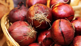 Wicker basket with red onion Stock Photos