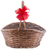 Wicker basket with red ribbon Royalty Free Stock Photos
