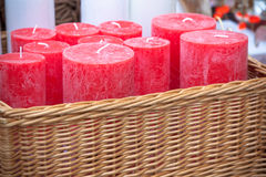 Wicker basket with red round candles Royalty Free Stock Image