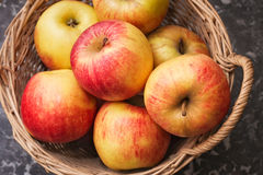 Wicker Basket of Ripe Apples Royalty Free Stock Photos