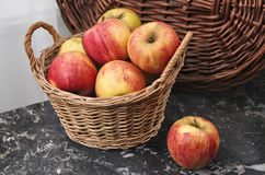 Wicker Basket of Ripe Apples Royalty Free Stock Images
