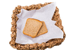 Wicker basket with roasted rye toasts. Stock Photo