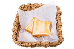 Wicker basket with roasted toasts. Royalty Free Stock Image