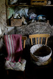 Wicker basket in a room of a basement Royalty Free Stock Images