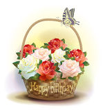 Wicker basket with roses. Stock Images