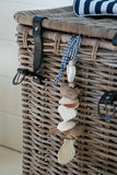 Wicker basket with sea chain and hearts Stock Photography