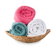 Wicker basket with soft rolled towels. On white background stock images