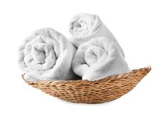 Wicker basket with soft rolled towels. On white background royalty free stock photos
