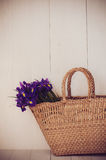 Wicker basket with spring flowers Stock Photos