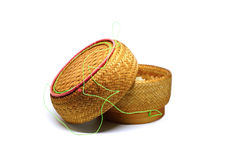 A wicker basket of sticky rice,bamboo woven texture. On white background royalty free stock images