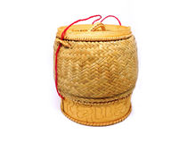 Wicker basket of sticky rice,bamboo woven texture. A wicker basket of sticky rice,bamboo woven texture on white background stock photography