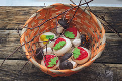 Wicker basket with sweet marshmallow. Branches of a tree Royalty Free Stock Photo