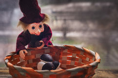 Wicker basket with sweet marshmallow, cheerful toy Royalty Free Stock Images