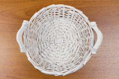 Wicker basket on table Stock Photo