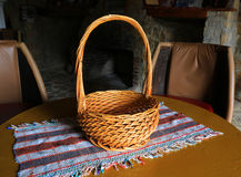 Wicker basket on tablecloth Stock Image