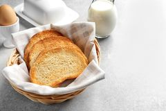 Wicker basket with tasty toasted bread Stock Images