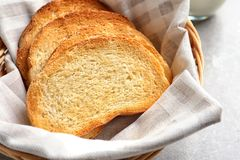 Wicker basket with tasty toasted bread Stock Photography