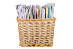 Wicker basket with textbooks and catalogs stock image