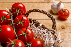 Wicker basket with tomatoes Royalty Free Stock Photography