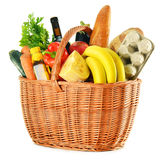 Wicker basket with variety of grocery products on white Royalty Free Stock Photo
