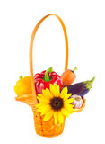 Wicker basket with vegetables and flower. Royalty Free Stock Photos
