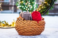 Wicker basket with warm blankets on the snow outside royalty free stock images