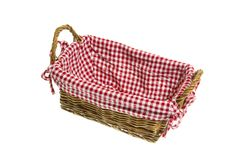 Wicker basket with a white/red checkered textile on white backgr Royalty Free Stock Image