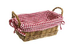 Wicker basket with a white/red checkered textile on white backgr Stock Image