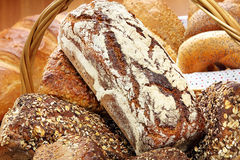 Wicker basket with wholegrain bread and rolls Stock Image