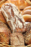 Wicker basket with wholegrain bread and rolls Royalty Free Stock Photo
