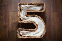 Wicker basket 5. Wicker basket in a shape of number five Royalty Free Stock Photo