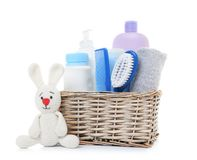 Free Wicker Basket With Baby Cosmetic Products And Knitted Rabbit Isolated Stock Photography - 145678432