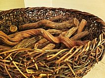 Wicker basket with wood Stock Photography