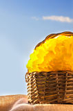 Wicker basket with yellow pompon Stock Images