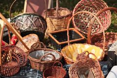 Wicker Baskets. For sale strewn across the ground Royalty Free Stock Photo