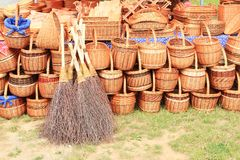 Wicker baskets and brooms. Wicker baskets and wicker brooms made from birch tree twigs on market for sell Royalty Free Stock Photography