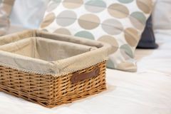 Wicker baskets in different size. On a white bed royalty free stock images