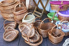 Wicker baskets exposed for sale at the market. Basketry and craftsmanship from natural material concept. Pile of different wicker baskets exposed for sale at the royalty free stock images