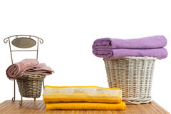 Wicker baskets full of clean colored towels Royalty Free Stock Images