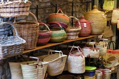 Wicker baskets in market stall Stock Photo