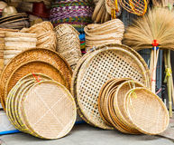 Wicker baskets. A pile of hand made wicker baskets in  a shop Royalty Free Stock Photos