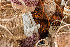 Wicker baskets and sneakers. Stock Image